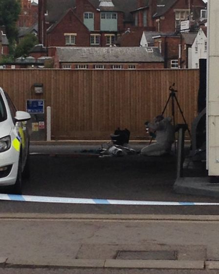 Forensics officers examining the forecourt of the Esso Garage in St Albans. Photo by Sophie Crockett