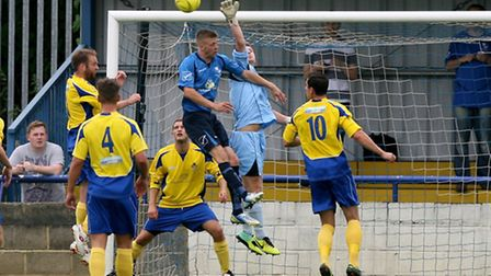 Tom Coulton punches the ball clear. Picture: Leigh Page