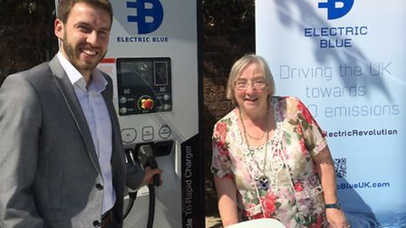 Councillor Gill Clark using the brand new St Albans electric taxi charger with Alex Calnan, MD of El