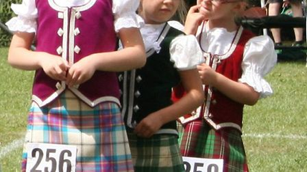 Three youngsters enjoying the Scottish dancing last year