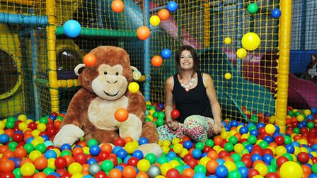 DJ's Jungle Adventure owner Helen Whittington and DJ the monkey celebrate the paly area reopening in