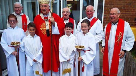 Cardinal with priests from SS Alban and Stephen Church and children from the school