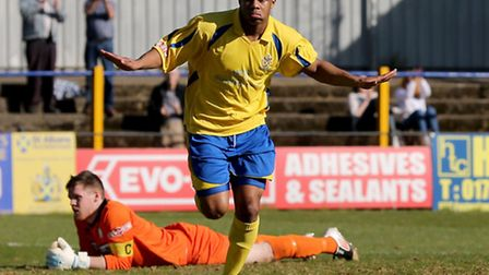 Greg Ngoyi peels away after scoring City's third goal. Picture by Leigh Page