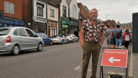 Cllr Chris Brazier stands on London Road where pedestrians have been forced to walk in the road afte