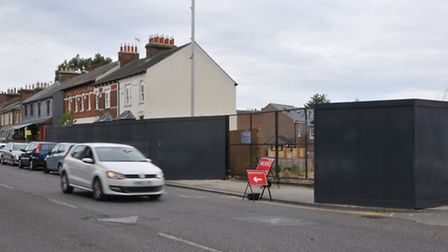 Pedestrians have been forced to walk along London Road after hoardings for the building site were er