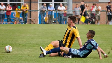 Remy Gordon slides in to score for St Neots Town in their 7-2 friendly defeat against Cambridge Unit