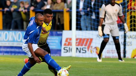 James Comley takes the ball away from Troy Deeney. Picture: Leigh Page