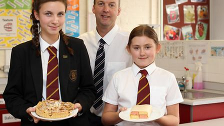Winners, Sophie Marriage and Emma Kitely with headteacher, and judge, Duncan Cooper.