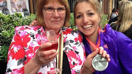 Julie Calvert, here after the London Marathon with Nicola's mother Julie, was made charity patron.