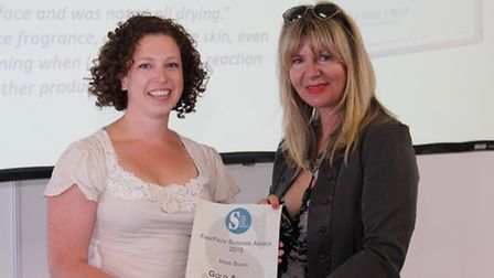 Eliza Riddell, from All Natural Soap, being presented with gold award for hard soaps by Janey Lee Gr