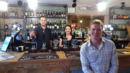 Great Northern owner Dan Gibney, foreground, with bar manager Sheri Edwards (left) and his assistant
