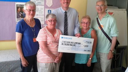 Ed Wallace presents a cheque to the Acorn Cancer Support Group.