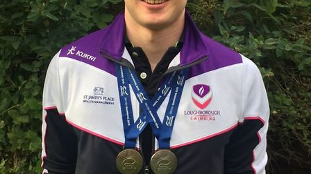St Ives swimmer Andy Weatheritt with his British Summer Championships medals.