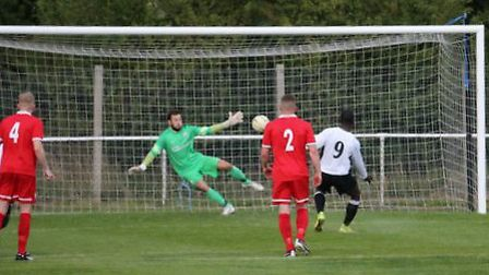 Carl Osbourne opens the scoring from the spot. Picture: Jim Whittamore