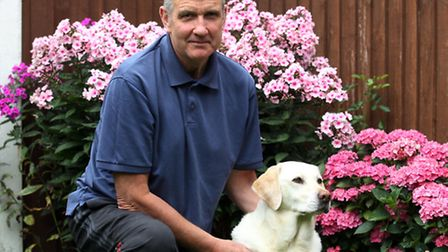 Pete Thomson with is dog, Abby