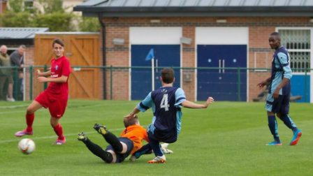Peter Clark scoring for St Neots Saints in their abandoned friendly against Team Bury on Tuesday nig