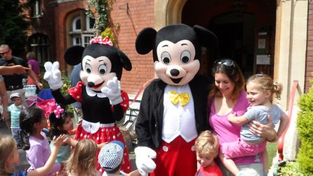 Parents, children and teachers were very excited by the arrival of Minnie and Mickey