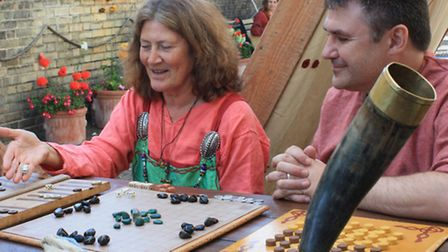 The Vikings enjoyed playing board games, and here, Avril Gurden plays Halatafal, a version of modern
