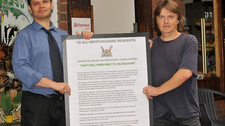 Herts Advertiser editor Matt Adams and campaigner Andy Love with the anti Helioslough letter outside