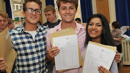 Sir John Lawes pupils Robin and Austen Fletcher and Shivani Patel with their GCSE results