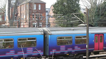 A train goes past houses in St Albans
