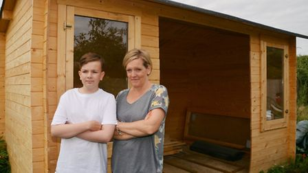 Chad Martindale with mum Sharron Brunton by the cabin