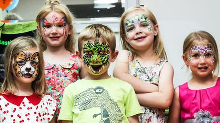Face painted children after raffle win