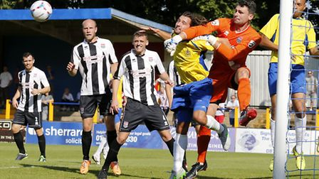 Steve Phillips punches clear under pressure from Billy Medlock. Picture: Leigh Page