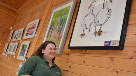 Hinchingbrooke Country Park, Art Exhibition, Caretaker Lesley Cann, looking at some work,