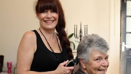 Gillian Robinson has her cut by Lisa Waller, owner of Bliss Hair
