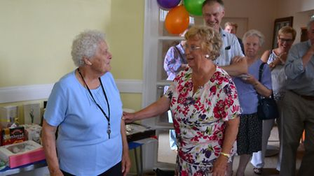 Freda Adlington presenting Doreen with some flowers in appreciation of all her hard work. PICTURE: G