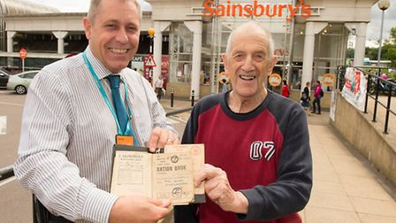 Copyright image 2015© John de Marris, 83, presents his and his family's ration books to Darren Scot