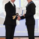 James Ross receives his certificate of course completion from Commodore Toby Williamson MVO RN, Comm