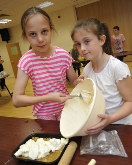 Junior Masterchef at One Leisure, Huntingdon, for summer holiday activities, (l-r) Alsion, and Saman