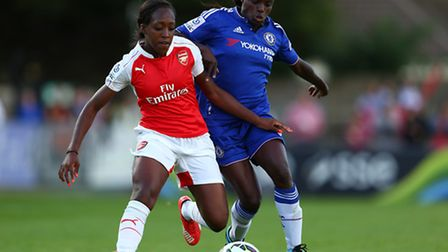 BOREHAMWOOD, ENGLAND - AUGUST 23: Danielle Carter of Arsenal Ladies battles for the ball with Eniol