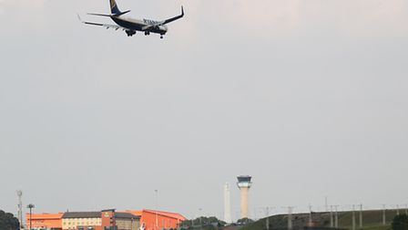 A Ryanair plane comes in to land at Luton airport