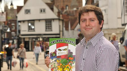 """Author Chris Boyle with his childrens book """"The Root Troops"""""""