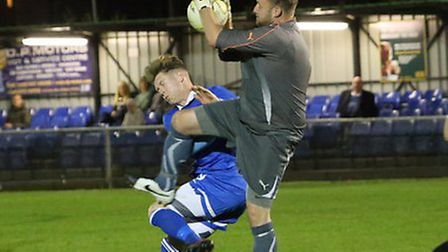 Lee Armitt clashes with Hoddesdon's goalkeeper. Picture: Jim Whittamore