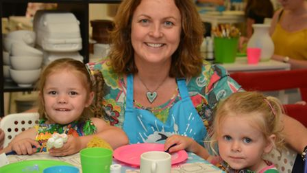 Crafty Monkey kids fun, St Neots, (l-r) Emily, owner Chrissy Brown, and Isobella,
