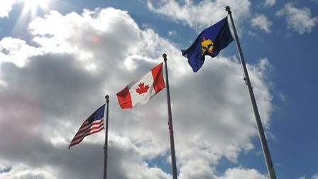 The American, Canadian and Vermont State flags wave in unison, a common sight around St. Albans and
