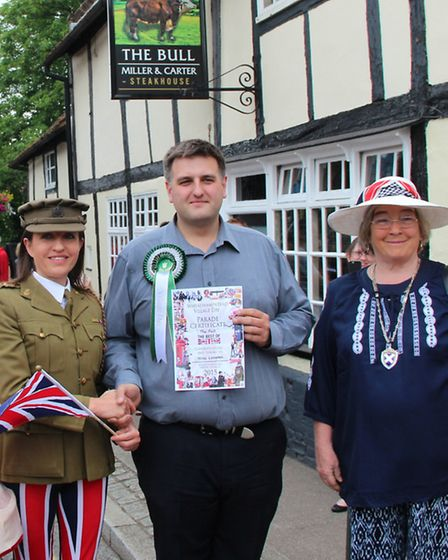 The Bull sign returns to its rightful place in Wheathampstead: Cllr Annie Brewster, left, presenting