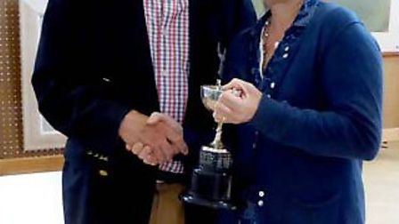 Jan Munro receiving the Terry Biggs Cup from Edward Bevin