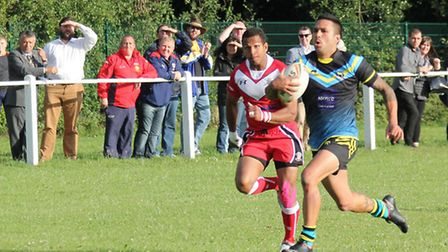 Tim Rangihuna on his way to score. Picture: Darryl Brown