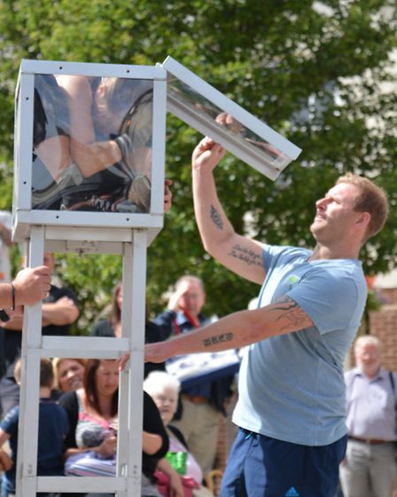 Street Performer Bendy Em, in Chequers Court, Huntingdon, with her assistant James, from Offord,