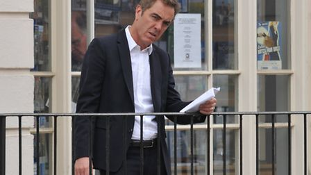 James Nesbitt learns some lines outside the old town hall during filming of Sky One's Lucky Man