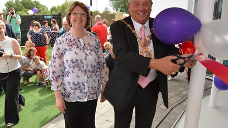 Valerie Taylor with the mayor of Huntingdon, Councillor Bill Hensley, cutting the ribbon.