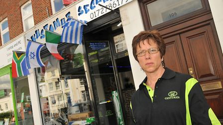 Emma Perkins outside Kustomys Security shop which has had the outside displays vandalised two weeks