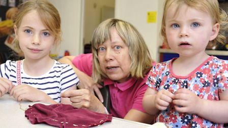 St Neots Museum kids activites, for half term, (l-r) Alexa, and Francesca, from St Neots, making a p