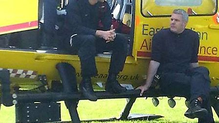 Prince William, working for East Anglian Air Ambulance, delivering a patient to Papworth Hospital. P