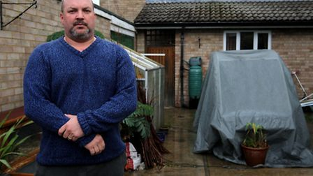 Jason Hort pictured outside his home where there was a burst water main